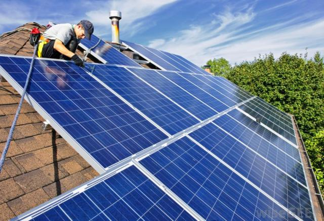 solar-panels-being-installed-on-a-residential-roof
